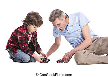 Grandfather and grandson - Smiling grandfather and his...