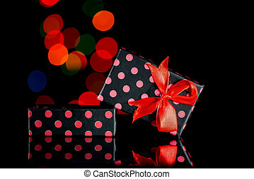 Gift boxes with polka dots and bokeh