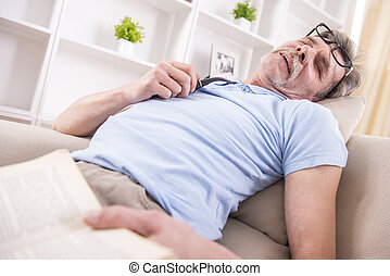 Grandfather and grandson - Senior man fell asleep while was...