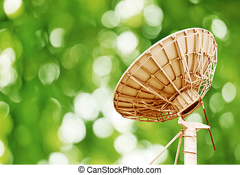 Satellite dish - Satellite antenna, blurred green background