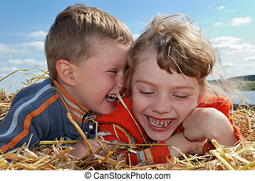 laughing Boy and girl outdoors - laughing Boy and girl...