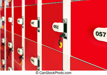 Lockers - Red lockers, neatly arranged on the wall.