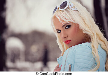 Beautiful blonde girl with sunglasses