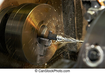 drilling a hole in blank on turning machine - Operation of...