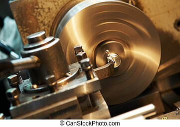 facing metal blank by cutter on lathe - Facing operation of...