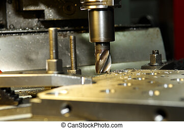 milling the metal blank - End-tooth vertical mill cutting...