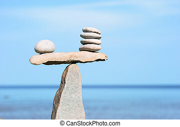 Proportionate - Balance of pebbles on the top of triangle...