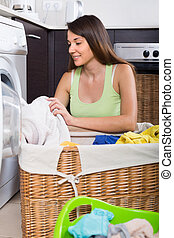 Woman with linen basket