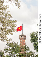 Vietnam flag with white flowers at Hanoi, Vietnam