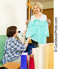 Pensioner bragging with new blouse