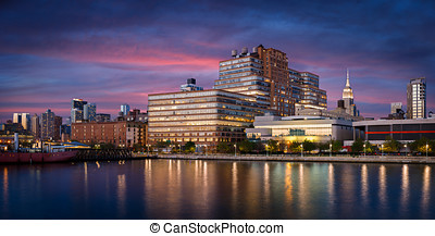 West Chelsea buildings at sunset from Hudson River, New York...