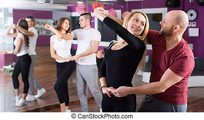 people having dancing class - Happy young people having...