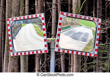 traffic mirror - two traffic mirror stand at the...