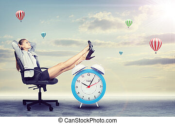 Woman in jacket and skirt sitting on chair Background of...
