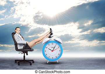 Woman in jacket and skirt sitting on chair Background of the...