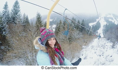 Girl on lift - On fifth lift rides smiling girl