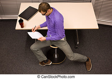 healthy lifestyle at office work - business man stretching...