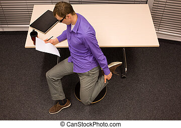 healthy lifestyle in workplace - business man stretching his...