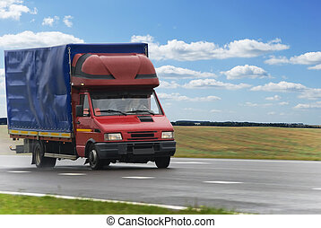 red delivery truck - single red middle delivery truck moving...