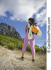 Woman trekker - Young adult woman treking in the mountains