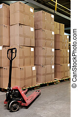 catron boxes and pallet truck in warehouse - Group of carton...