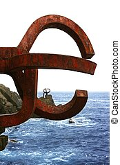 Chillida rusty steel sculpture in San Sebastian sea: Peine...