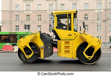 Yellow Asphalt Paving Machine - Heavy yellow roller...