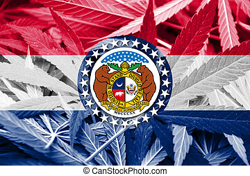 Missouri State Flag on cannabis background. Drug policy....