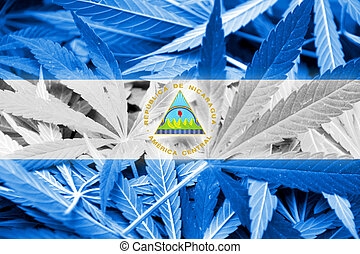 Nicaragua Flag on cannabis background. Drug policy....