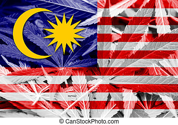 Malaysia Flag on cannabis background. Drug policy....