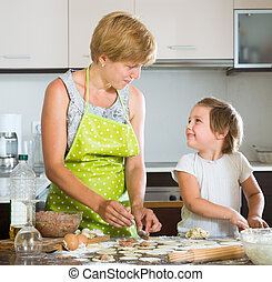 Child with mother making meat dumplings - Happy child with...