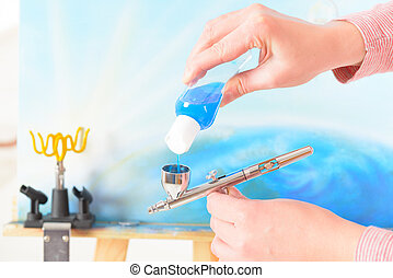 Airbrush - Adding blue paint to a professional airbrush