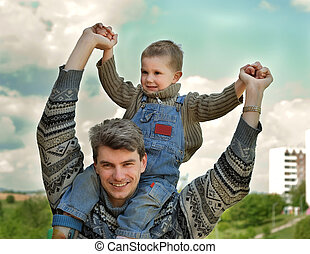 father and son (on the shoulders) - Little joyful boy...