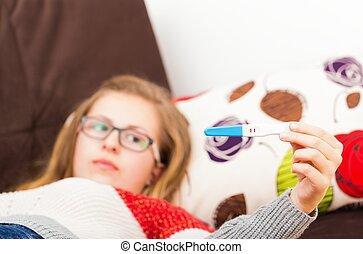 Teenage Girl Expecting Baby - Teenage girl showing her...