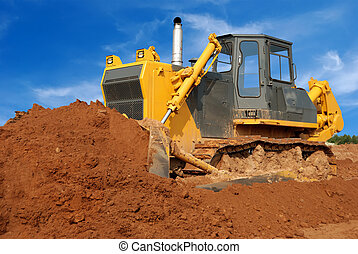 Close view of heavy bulldozer moving sand in sandpit