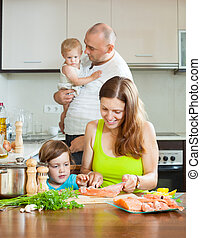 parents with children docile fish cooking in a home kitchen...