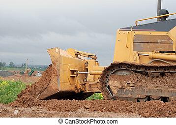small bulldozer blade in action