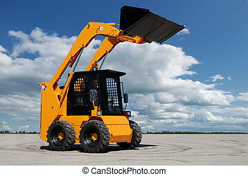 skid steer loader with full raised bucket outdoors