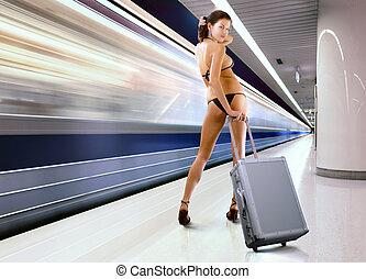 beautiful woman with luggage in subway - beautiful woman in...