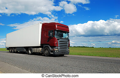 claret lorry with white trailer on the highway over blue...