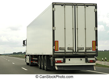 rear of white truck on the highway - single white truck on...