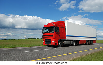 red lorry with white trailer on the highway over blue cloudy...