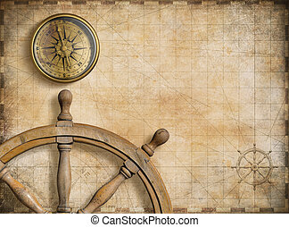 steering wheel and compass with vintage nautical map...