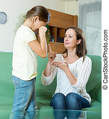 Woman scolds the child