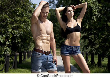 Beautiful sexy young couple in blue jeans - Portrait of a...