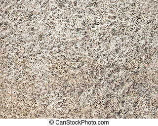 solid porous natural stone - wall of a very old brown rough...