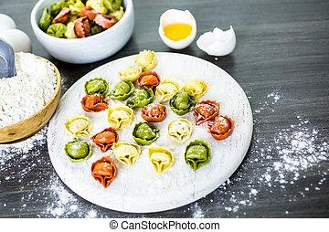 Tortellini - Making fresh rainbow cheese tortellini with...