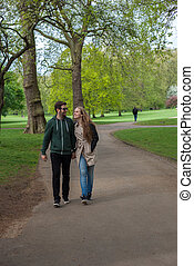 tourists walking in London park - couple of tourists walking...