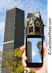 tourist taking photo of kaiser wilhelm church - travel...