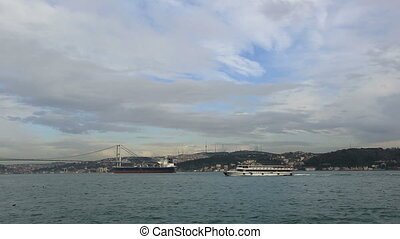 time lapse large container ship passing Bosphorus Istanbul...